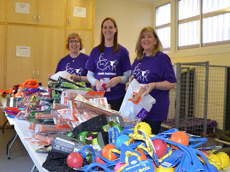 Volunteers helping to pack Purina goody bags