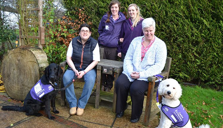 Partners and their canine partners assistance dogs trained by Clare and Els