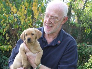 Puppy socialiser Roger with puppy Pixie