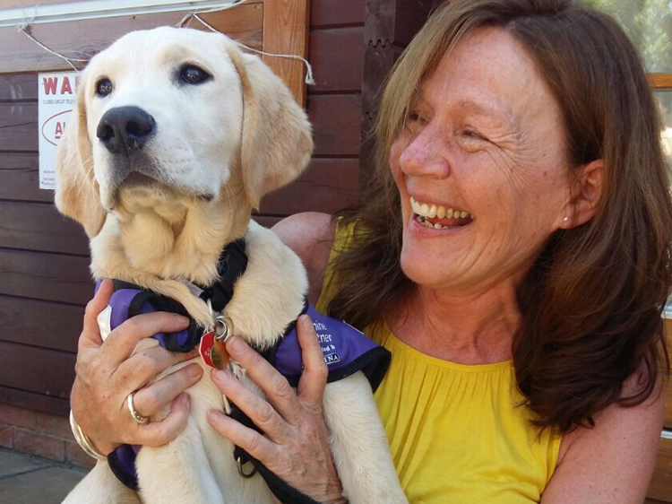 Canine Partners Director Anne Yendell with puppy Olly