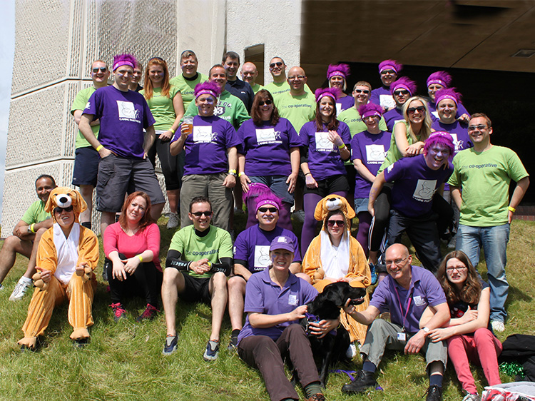 A Corporate Fundraising group wearing Canine Partners t-shirts