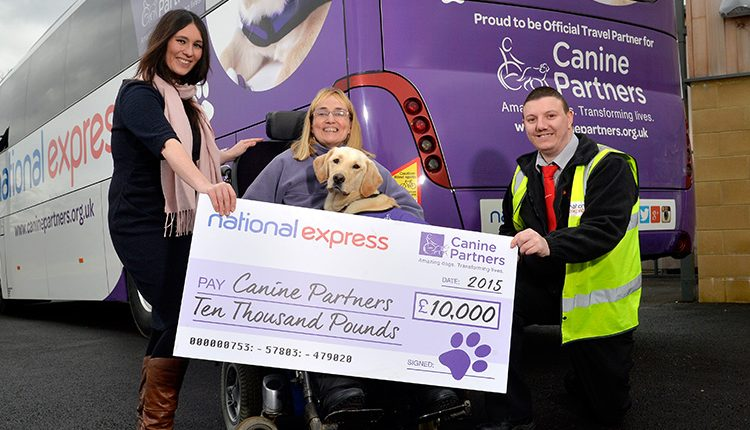 National Express presenting a cheque to partnership Kate and May for £1,000 to help train more assistance dogs