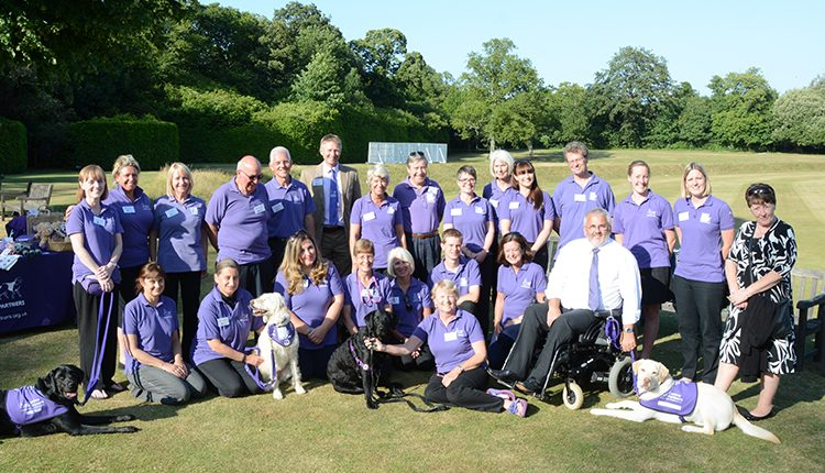 Canine Partners staff, volunteers and partners posing in Arundel