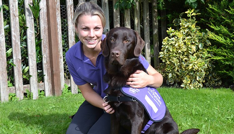 Advanced trainer Sara Trott with chocolate labrador