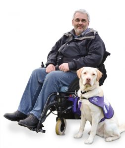 Martin Smailes with wheelchair assistance dog Keith