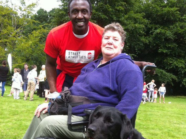 Athlete Linford Christie with Sandra Jackson and Erwin