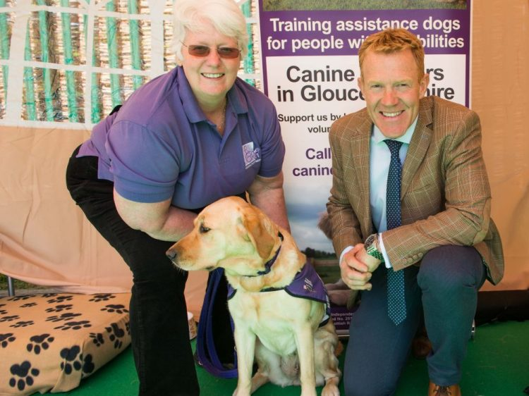 Countryfile presenter Adam Henson with Canine Partners dog Helena and volunteer Jean King