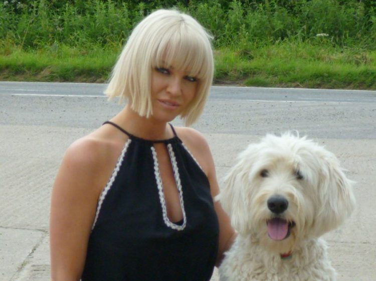 Girls Aloud singer Sarah harding with Canine Partners demo dog Rio