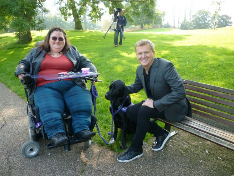 TV presenter Aled Jones with partnership Hannah-Lou Blackall and assistance dog Higgins