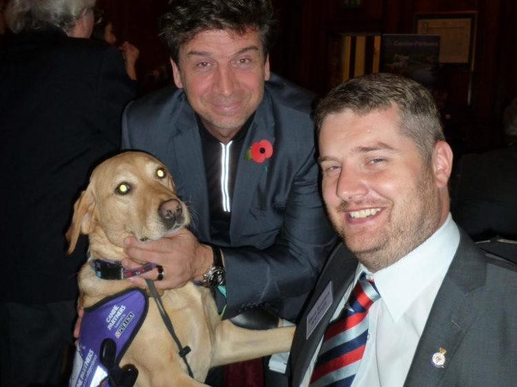 TV presenter Nick Knowles with Steve Brookes and assistance dog Kizzie