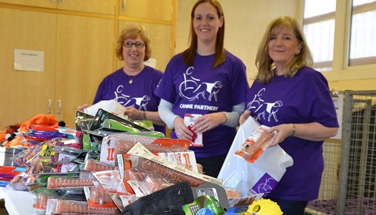 Purina volunteers packing goody bags for Canine Partners
