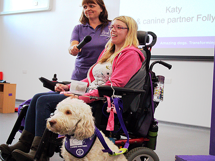 Partner Katy Evans giving a presentation for Canine Partners with Community Fundraising Manager Helen, raising awareness of the Charity