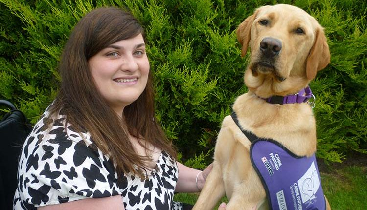 Partnership Clare and her assistance dog Griffin closeup