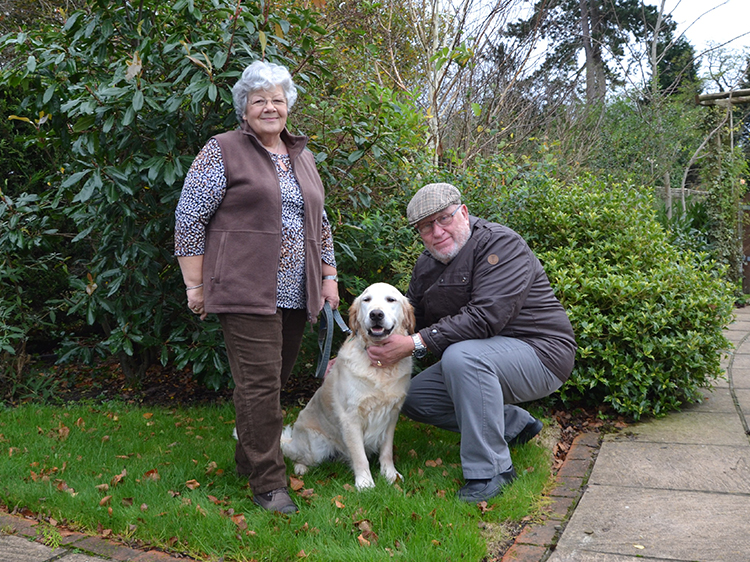 Canine Partners fostering volunteers Pat and John
