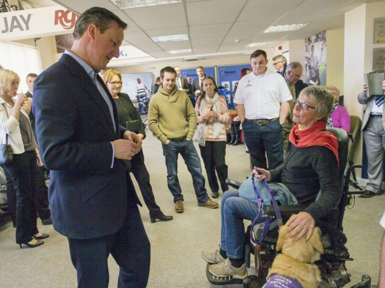 Jane Usher and assistance dog Jason meeting David Cameron