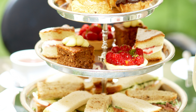 Afternoon tea cakes and sandwiches on a silver stand