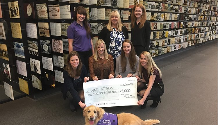 HSBC Canary Wharf team with cheque for £5,000