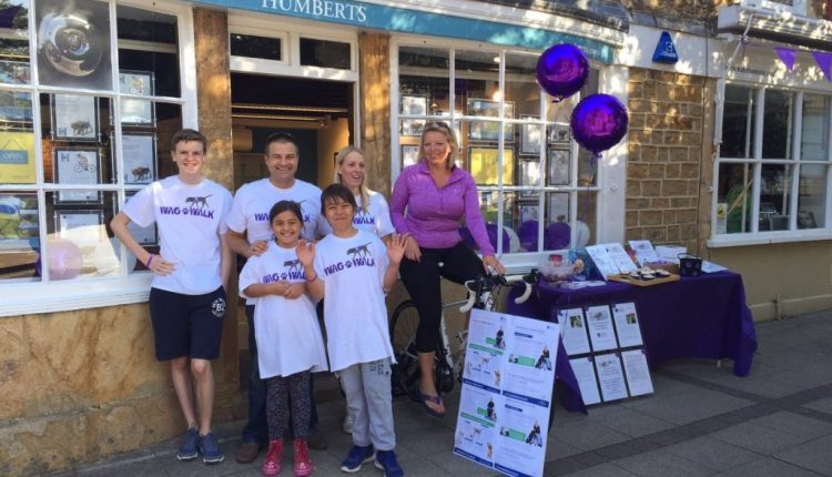 Humberts Yeoville team outside branch taking part in Great Humberts Cycle to raise money for Canine Partners