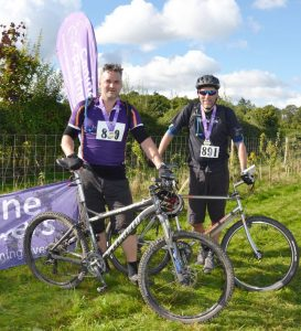 Two cyclists with their medals at Pedal for Paws cycling event in West Sussex