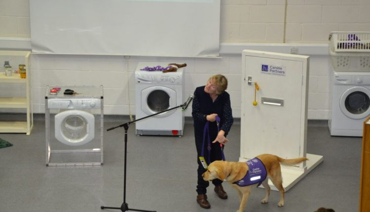 Volunteer doing a presentation of what Canine Partners assistance dogs can do
