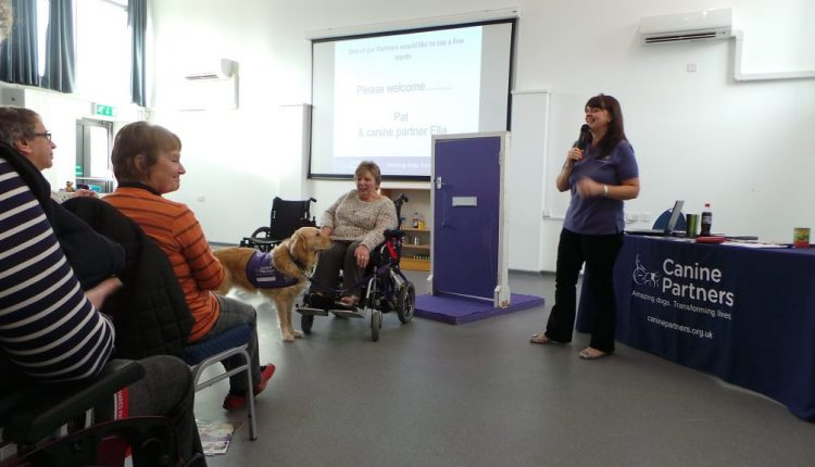 Helen Watkinson of Canine Partners explaining what the assistance dogs can do for people with disabilities