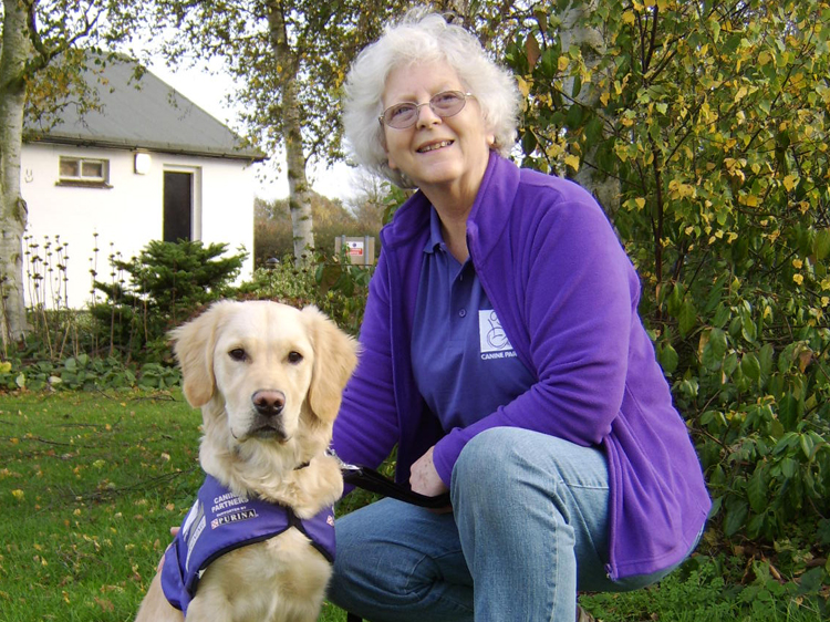 Puppy socialiser Gus Doyle with assistance dog in training