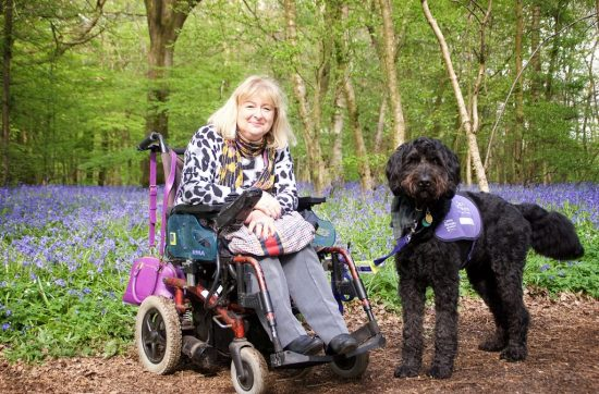 Claire Graham and canine partner Frankland at the Arlington Bluebell Walk