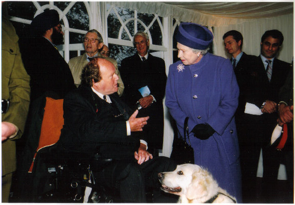 The Queen meeting partnership Gary and canine partner Gracie in June 2004