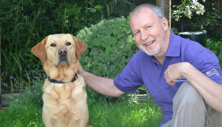 Jim Cook with dog in training